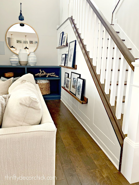 staircase with picture shelves