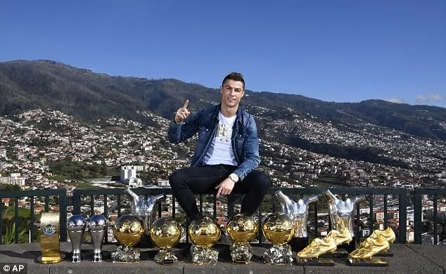 Cristiano Ronaldo Poses With His 15 Individual Trophies