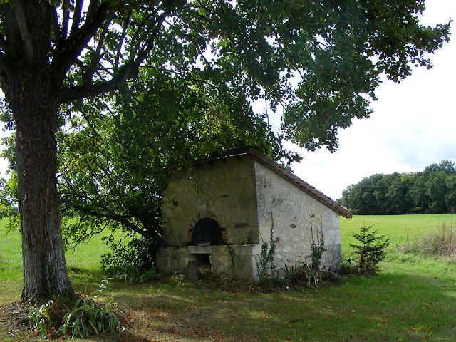 Restored bread oven in a garden, Indre et Loire, France. Photo by Loire Valley Time Travel.