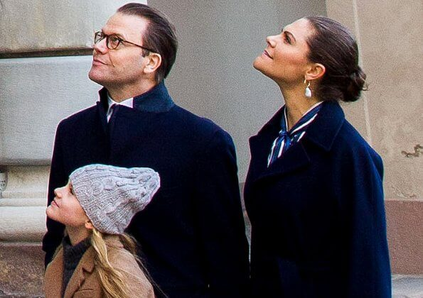 Crown Princess Victoria wore a vertical striped bow blouse form Gant, and baroque pearl earrings from Cravingfor Stockholm. Estelle wore a camel coat