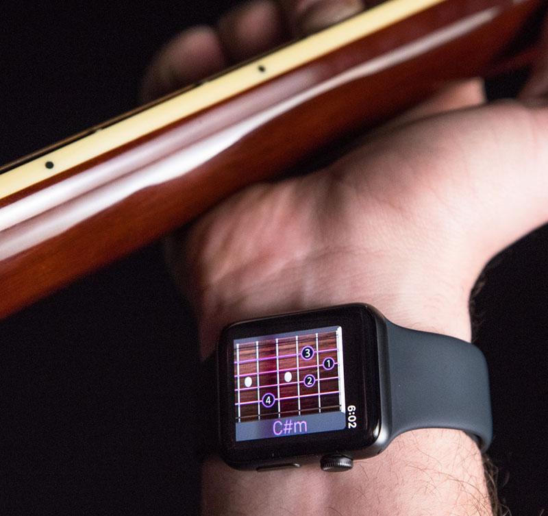 Wristruments. Учитель игре на гитаре