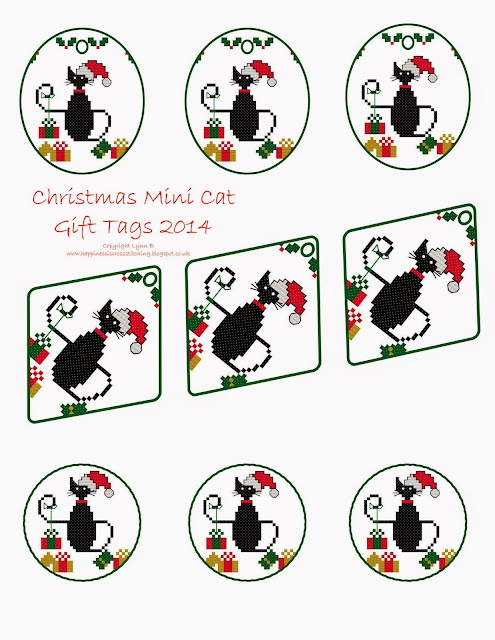 Free mini black cat digital gift tags for cross stitch featuring a Christmas themed Mini Black Cat cross stitch surrounded by parcels and holly leaves, all very cute!
