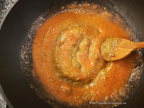 Frying tomato puree and masala
