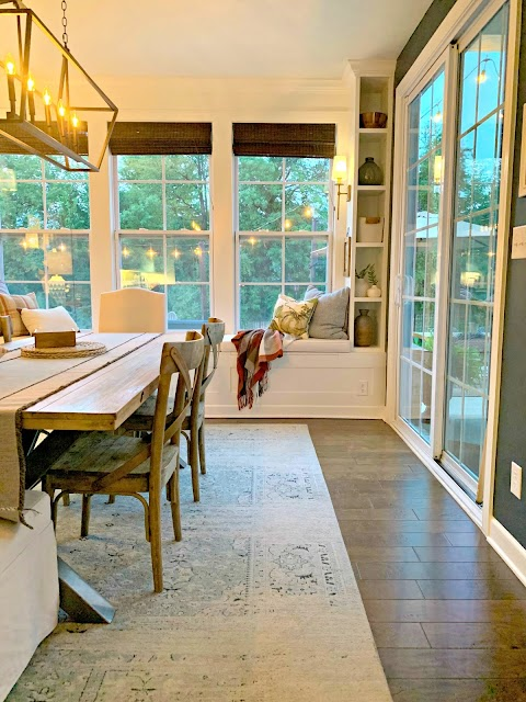 morning/dining room with window seat and bookcases