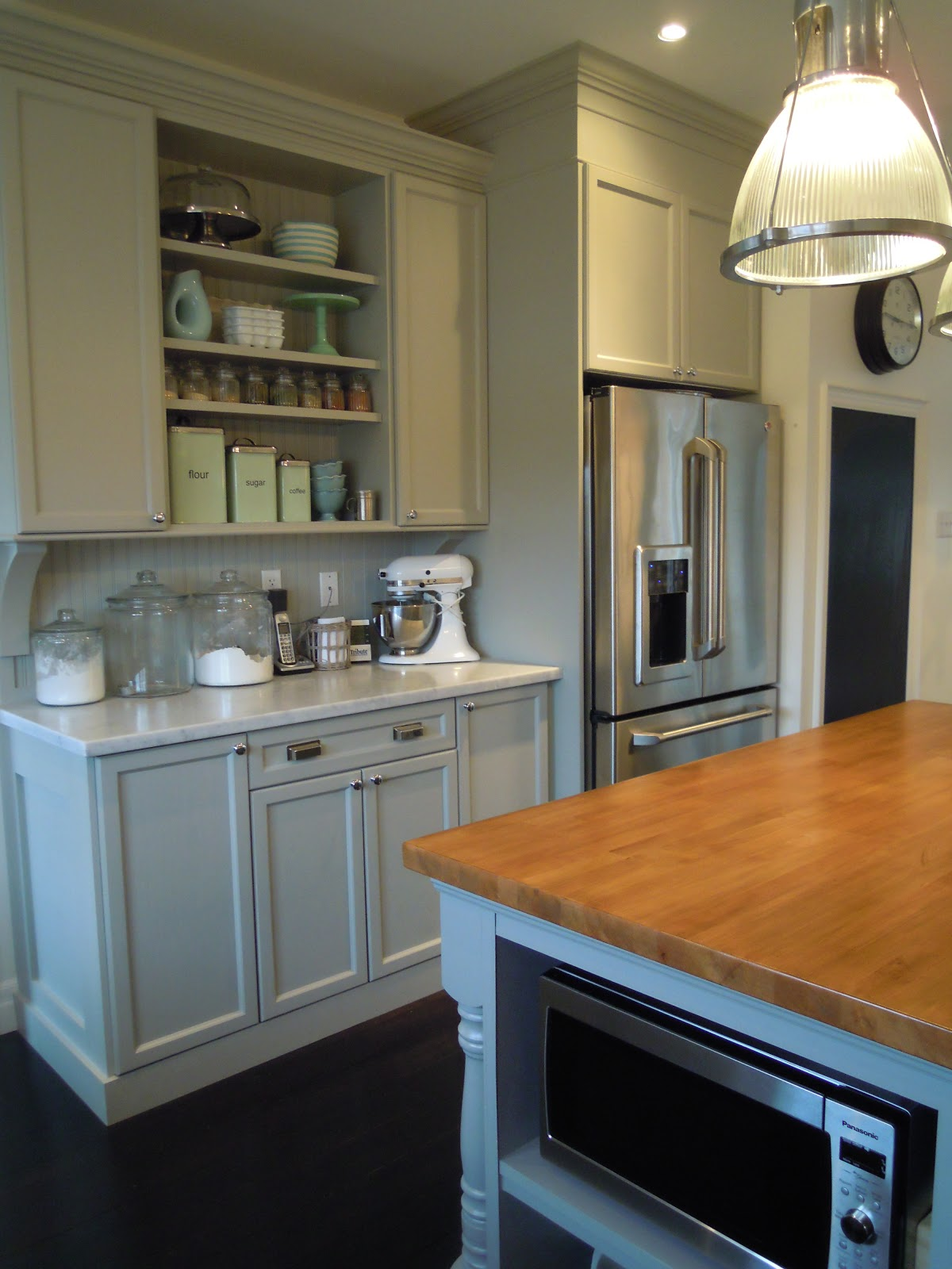 White wood finally our completed kitchen from builder for Basic kitchen cupboards
