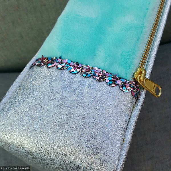 side of handbag in mint fur, silver holographic with glitter trim