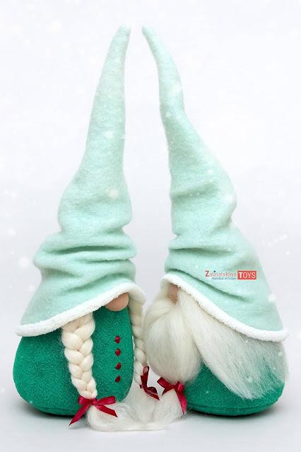 two plush Christmas gnomes with Scandinavian felt hats by sewing patterns of Zatinatskaya Natalia