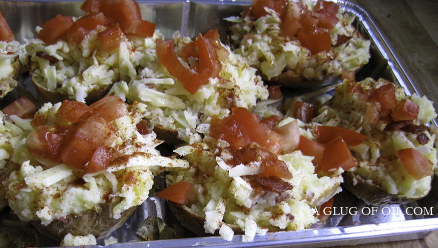 Cheesy Bacony Jacket Potatoes ready for the oven