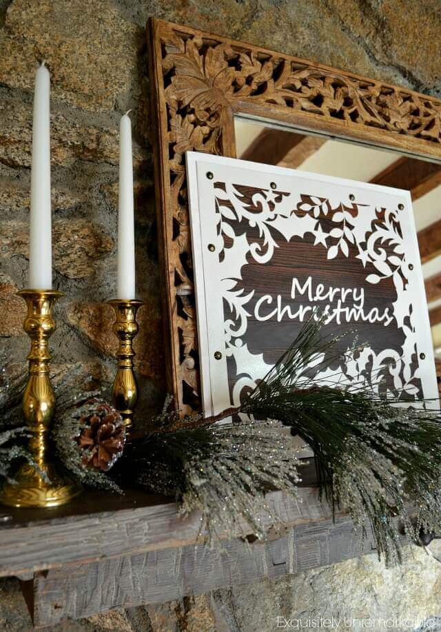 Merry Christmas Sign From A Gift Bag on the fireplace