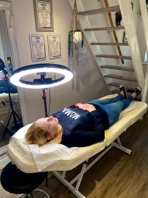 Having permanent make up at Dreamcatching Ink in Benfleet, Essex. Showing me lying on a treatment bed with a ring light near my face.