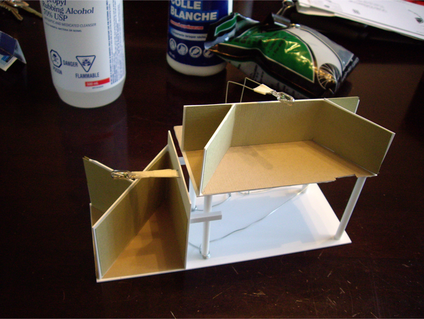 Scratch built removable interior made from styrene and cardstock for a DPM Cutting Scissor's Co. kit