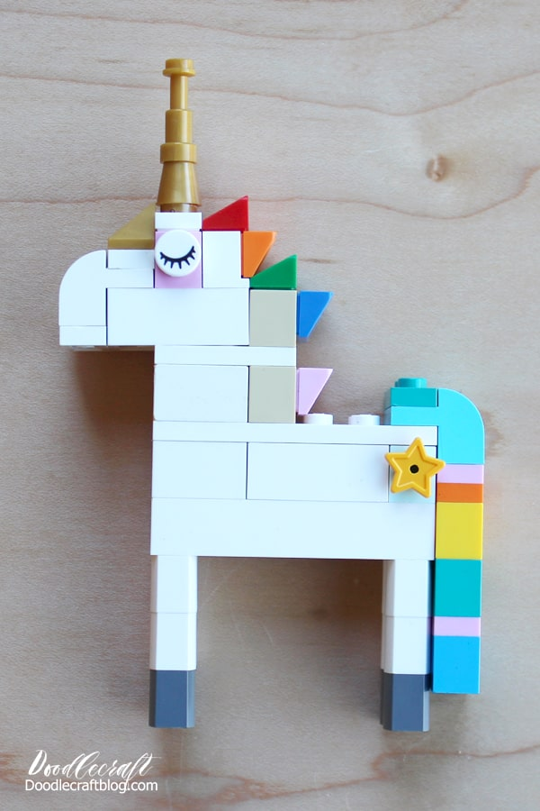 Build the most epic Lego Unicorn with a rainbow colored mane, gold tiara and horn, rainbow colored waterfall tail and star cutie mark on the flank!