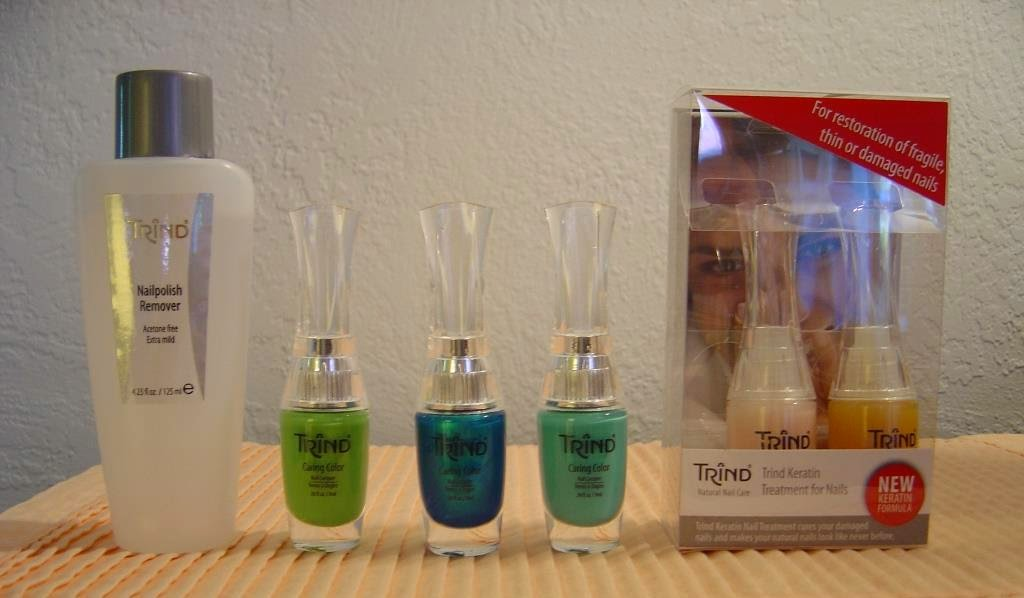 Trind Nail Polish Remover, three nail polishes, and Keratin Treatment for nails