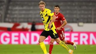 هالاند مهاجم فريق دورتموند الألماني على قائمة اهتمام نادي برشلونة الإسباني
