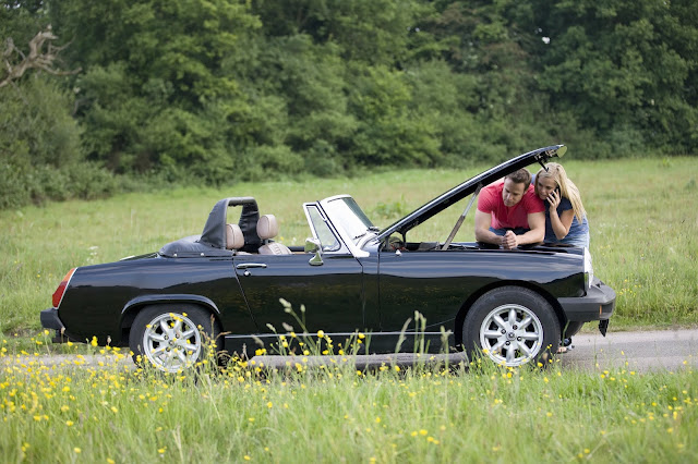young couple classic car breakdown