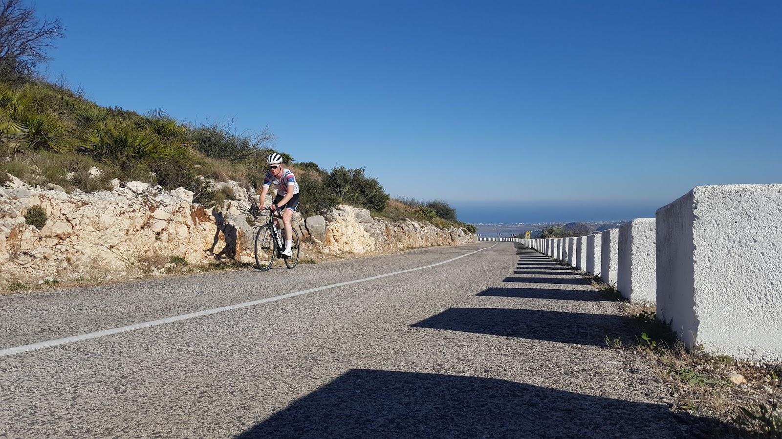 Cyclist climbing Vall d'ebo, Costa Blanca, Alicante, Spain