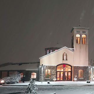 Church at night with Christmas Snow