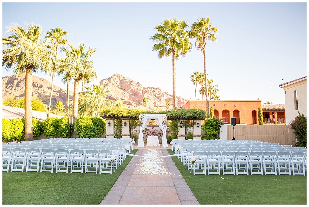 ceremony set up with Camelback view with whote rose petals down the aisle at Omni Montelucia wedding