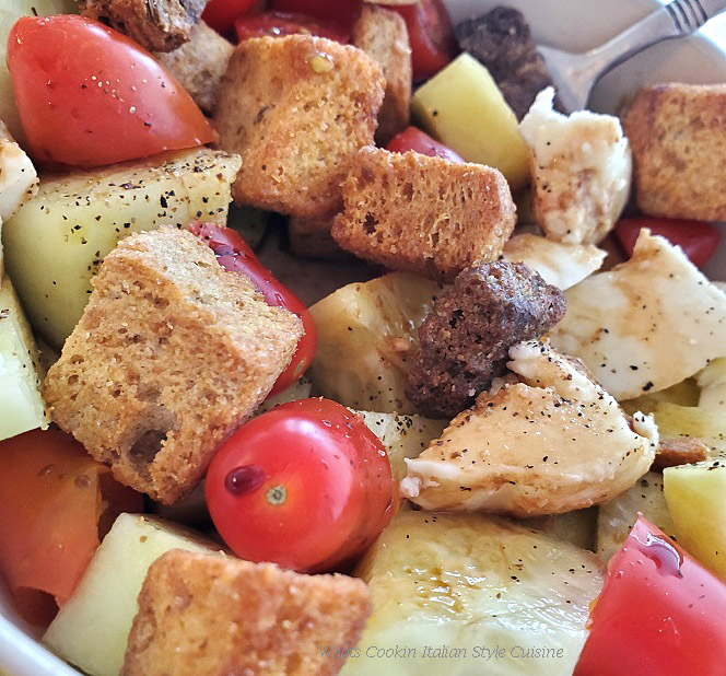 this is a tomato and cucumber salad with all kinds of toasted breads