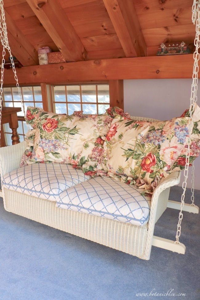indoor white wicker swing in a post and beam house with ideas for you to create your own swing area