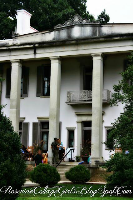 Belle Meade Plantation | Picture of a two story white house with shutters around the window and a porch above the doors | Belle Meade Plantation | rosevinecottagegirls.com