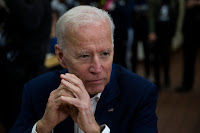 Former Vice President Joe Biden listens to voter in Los Angeles on Wednesday. The vice president is reportedly preparing a climate plan that he believes can appeal to blue-collar Trump voters. (Credit: ASSOCIATED PRESS/JAE C. HONG)) Click to Enlarge.