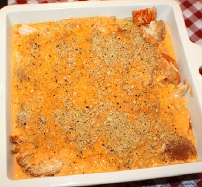 this is a casserole made with chicken and hot sauce with pasta mac and cheese flavors