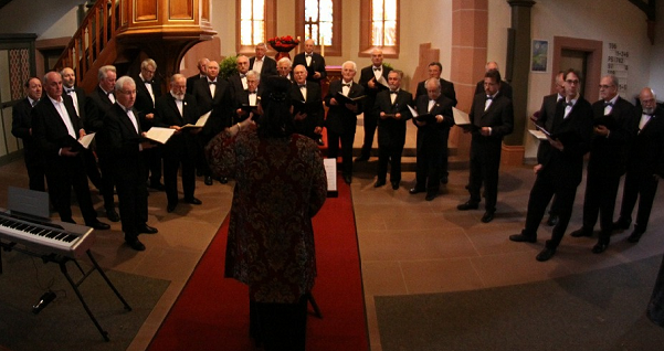 mail voice church choir performing in the sanctuary area of a church