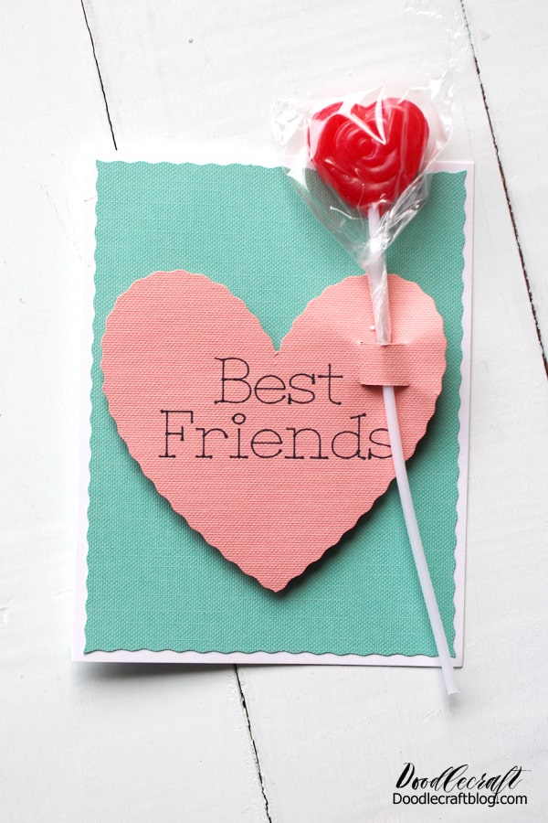 Use the Cricut Maker and Wavy Cut Blade to make conversation hearts inspired Valentine's day cards. This cute Valentine Card inspired by conversation hearts is easy to make using the Cricut Maker, drawing pen and the wavy cut blade. Insert a lollipop for the perfect Valentine's Day gift!