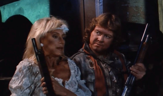 Sandahl Bergman and Roddy Piper in Hell Comes to Frogtown, 1988