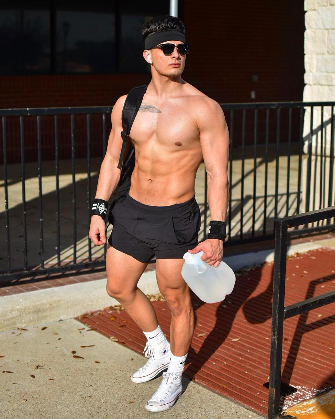 fit-young-bare-chest-bro-walking-city-sunglasses-summertime-gays