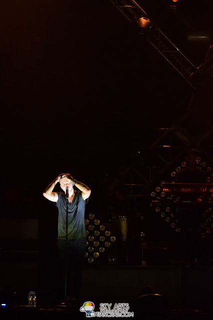 When spotlight shooting from the bottom OneRepublic Native Live in Malaysia 2013