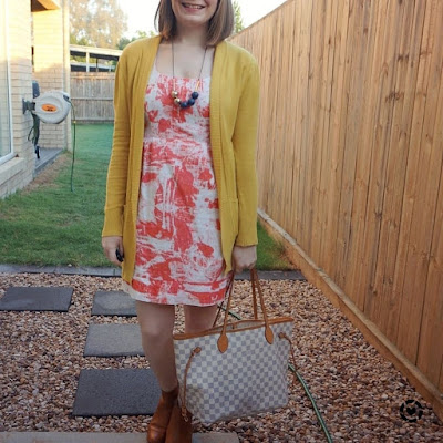 awayfromtheblue Instagram | orange printed sheath dress with mustard yellow cardigan colourful office outfit