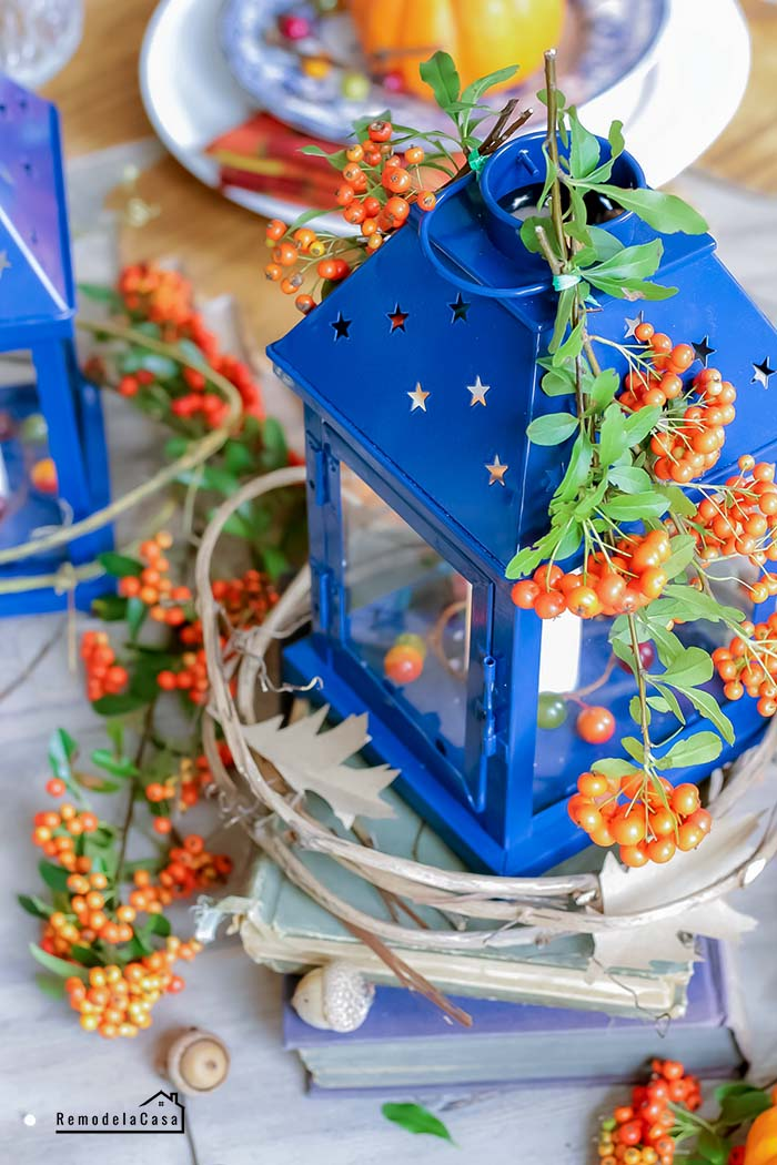 Blue lanterns and orange berries centerpiece