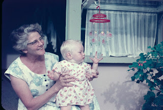 Grandma with me at the front steps in 1960