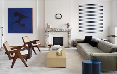 transitional living room with Pierre Jeanneret chairs, modern art and clean lines sofa