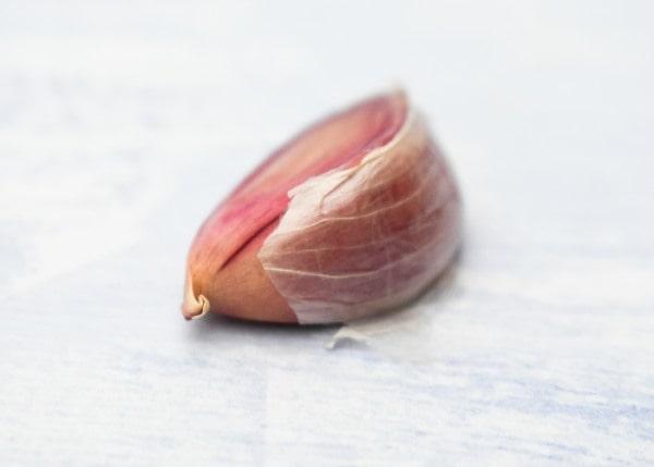 clove of garlic, skin on