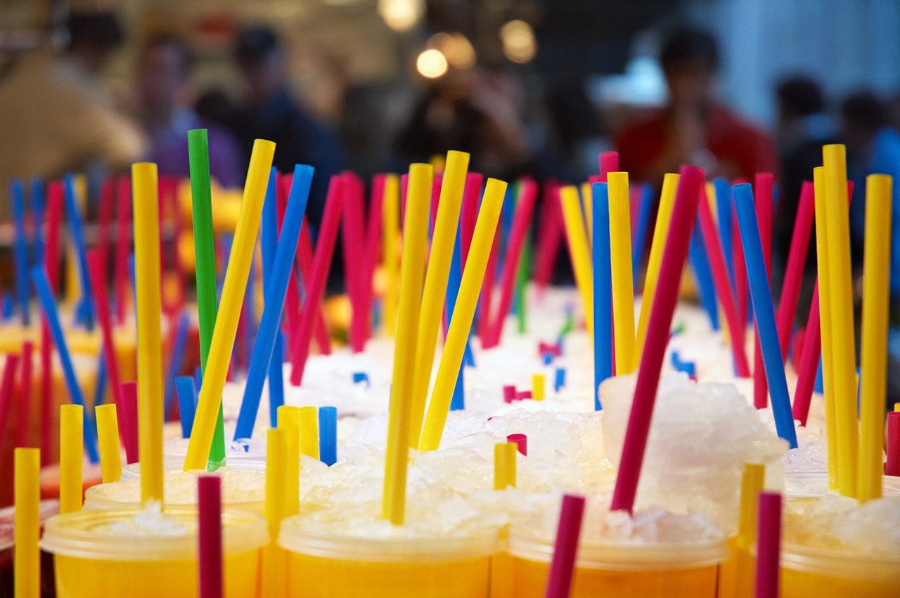Juice with colorful straws at Sant Josep Market or La Boqueria Marquet in Barcelona