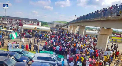 Photos As #EndSARS Protesters Occupy Expressway In Abuja
