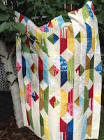 http://quiltersenjoycolor.blogspot.ca/2016/08/split-triangle-row-quilt-step-1.html
