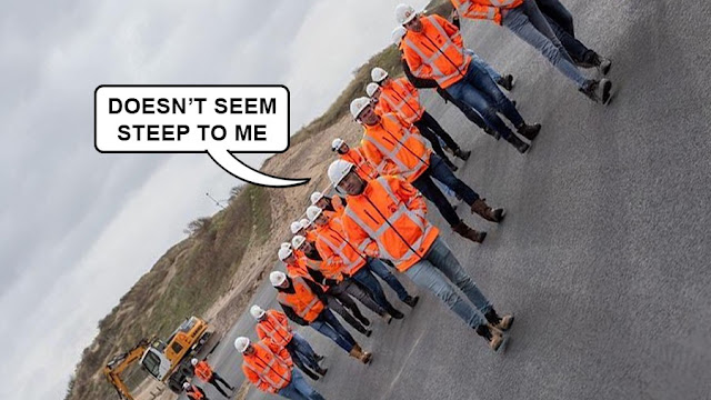 """Orange-vested workers on an exaggerated slope, one of them saying """"doesn't look steep to me"""""""