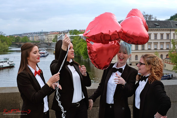 Black tie and inflatable red hearts. The Charles Bridge in Spring Prague by Travel and Lifestyle Photographer Kent Johnson.