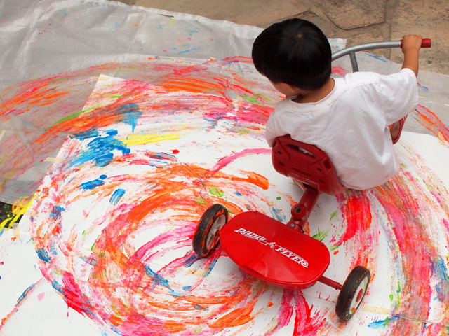 Boy making Tricycle Circles with his bike:  super fun action process art activity with kids