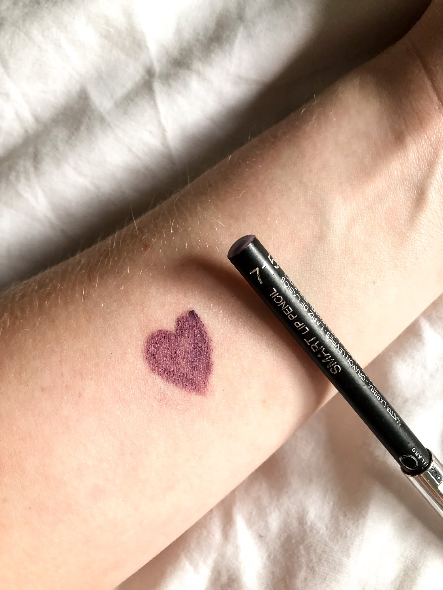 Kiko lip pencil review and swatches in shade peony violet.