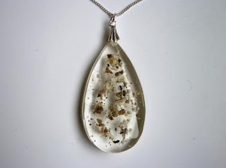 Teardrop shaped pendant containing ashes
