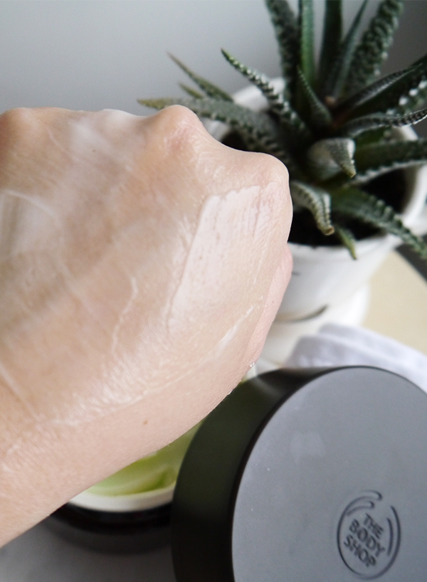 The Body Shop Spa of the World Ethiopian Green Coffee Cream Firming Body Cream whipped texture on hand