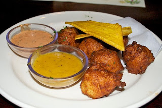 Golden brown Curry Garri Fritters are a favorite recipe of Western Africa made with ground cassava flour, hot curry paste and spices fried into delicious snacks. #Africa #recipes #international