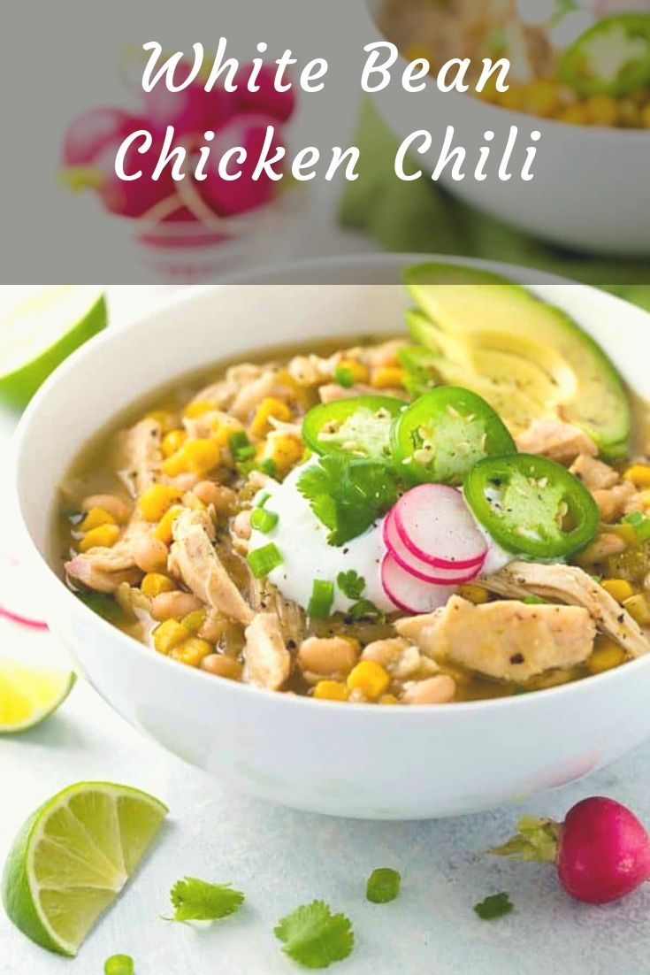 White bean chicken chili prepared in a crockpot with whole roasted jalapenos, tender beans, corn, and lean chicken breast.