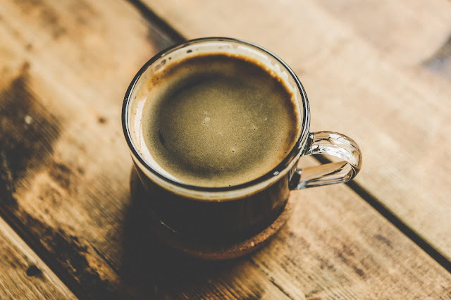 Photo by Nick Karvounis on Unsplash cup of coffee on wooden table