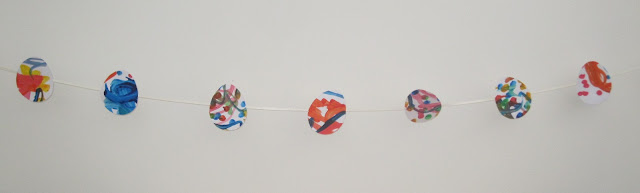 Bunting with egg shapes hanging from it